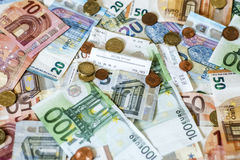 Savings Cash money concept euro banknotes all sizes and cent coins on desk bill pay store text sum total save Stock Photography