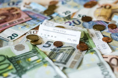 Savings Cash money concept euro banknotes all sizes and cent coins on desk bill pay store text sum total save Royalty Free Stock Image