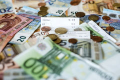 Savings Cash money concept euro banknotes all sizes and cent coins on desk bill pay store text sum total save. Savings Cash money concept euro banknotes of all Stock Images