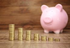 Savings concept. Coins in row and blurred Royalty Free Stock Photos