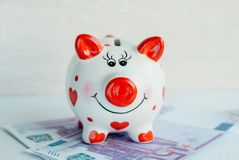 Funny piggy bank with money. Savings concept. Funny piggy bank with money Stock Images