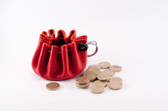 Savings concept. With red money pouch and several pound coins Stock Photography