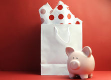 Savings concept with white shopping bag, red polka dot tissue paper Stock Image