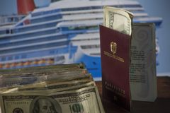 Savings destined to cruise by the sea- dollars and Colombian money with the cruise in the background royalty free stock image