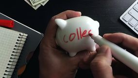 Savings for education. Man writing word pension on a side of college stock footage