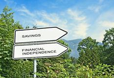 Savings and financial independence. Road signs to savings and financial independence Royalty Free Stock Photos