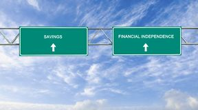 Savings and financial independence. Road signs to savings and financial independence Royalty Free Stock Photo