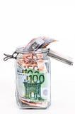 Savings in glass jar Royalty Free Stock Images