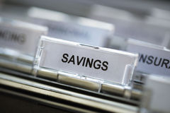 Savings heading in filing cabinet Stock Photography