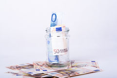 Savings hidden in a jar Stock Images