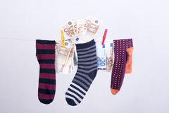 Savings hidden in a sock Stock Image