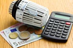 Savings In Heating Royalty Free Stock Photos