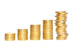 Savings, increasing columns of gold coins isolated Royalty Free Stock Photo