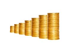Savings, increasing columns of gold coins isolated on white. Background Stock Photos