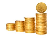 Savings, increasing columns of gold coins isolated on white Royalty Free Stock Photo
