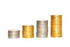 Savings, increasing columns of gold and silver coins isolated Royalty Free Stock Photos
