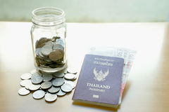 Savings a jar with currency for travel Royalty Free Stock Image