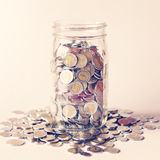 Savings in jar with vintage color tone process Stock Photography