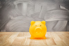 Savings money for buying a house or shopping, piggy bank concept. Royalty Free Stock Image