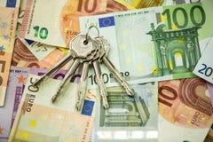 Savings money, buying new house. Keys savings money, buying new house Stock Photo