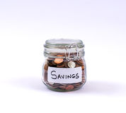 Savings Money Jar. Of coins concept for saving, investment, retirement or education stock photos