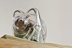 Savings in a piggy bank high up stock photography