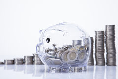 Savings in piggy bank! A lot of money!. Isolated on white background Stock Photos