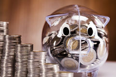 Savings in piggy bank! A lot of money!. On white background Stock Photos