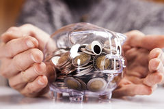 Savings in piggy bank! A lot of money!. On white background Royalty Free Stock Photos