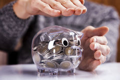 Savings in piggy bank! A lot of money!. On white background Stock Photography