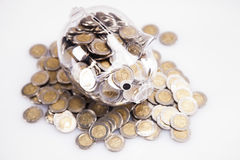 Savings in piggy bank! A lot of money!. Isolated on white background Royalty Free Stock Photo