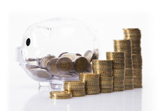 Savings in piggy bank! A lot of money!. Isolated on white background Stock Image