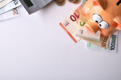 Savings with piggy bank and money and calculator top Stock Images