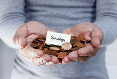 Savings plan with loose coins. Man holding coins for savings plan Royalty Free Stock Photo