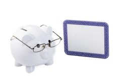 Savings Professor: Piggy bank ready teach how to save money Stock Photography