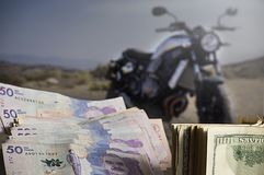 Savings money for motorcycle purchase royalty free stock photos