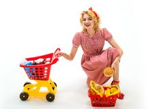 Savings on purchase. retro happy woman go shopping. happy woman in shop. shopping girl with full cart. vintage housewife. Woman isolated on white. Shopping time stock photography