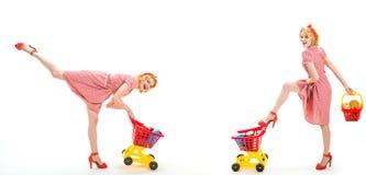 Savings on purchases. retro women go shopping with full cart. happy shopping girls with full cart. online shopping app stock photo