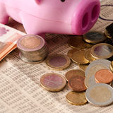 Savings represented by a pink pig Royalty Free Stock Images
