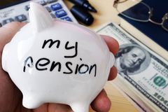 Savings for retirement. My pension on a piggy bank side. Savings for retirement. My pension written on a piggy bank side Royalty Free Stock Image