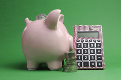 Savings and Shopping Sale concept with piggy bank, stack of coins and calculator Stock Image