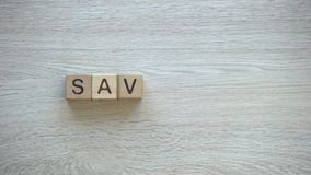 Savings, stop motion word on wooden cubes, family budget planning, economy. Stock footage stock video footage
