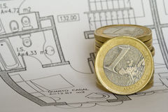 Savings to buy a house. How to get the savings to buy a house (focus on the coin stock photography