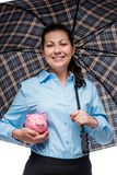 Savings under reliable protection! Happy businesswoman. With a piggy bank under an umbrella stock photo