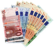 Savings wealth, different colorful euro isolated. Pile of different grunge (grungy) colourful money (savings in 10, 20, 50, 100 euro banknotes) isolated on white Royalty Free Stock Photo
