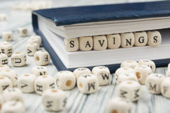 SAVINGS word written on wood block. Wooden ABC Royalty Free Stock Photos
