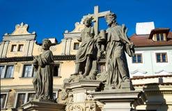 Savior and holy Cosmas and Damian statue on the Charles Bridge Stock Image