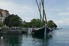 Savoie traditional boat at Evian-les-Bains. Port at Évian-les-Bains on lake Geneva stock photos