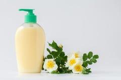 Savon liquide avec le fleuriste photo libre de droits