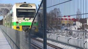 Passenger commuter train on the railway bridge. Savonlinna, Finland. SAVONLINNA, FINLAND - MARCH 03, 2018: Passenger commuter train on the railway bridge stock video footage